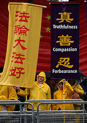 © Licensed to London News Pictures. 21/10/2015. London, UK. Protestors stand opposite Downing Street before the visit of Chinese President Xi Jinping. Photo credit: Peter Macdiarmid/LNP