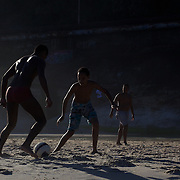 Local youngsters play football on Sao Conrado beach, Rio de Janeiro,  Brazil. 8th July 2010. Photo Tim Clayton....