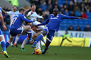 Jack Grealish of Aston Villa is fouled by Sol Bamba of Cardiff city ® and Aron Gunnarsson of Cardiff city (l). EFL Skybet championship match, Cardiff city v Aston Villa at the Cardiff City Stadium in Cardiff, South Wales on Monday 2nd January 2017.<br /> pic by Andrew Orchard, Andrew Orchard sports photography.