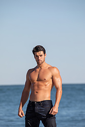 hot shirtless man at the ocean
