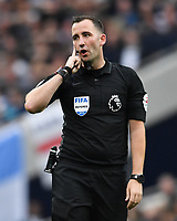 Football - 2019 / 2020 Premier League - Tottenham Hotspur vs. Aston Villa<br /> <br /> Referee Chris Kavanagh waits on a penalty decision, at The Tottenham Hotspur Stadium.<br /> <br /> COLORSPORT/ASHLEY WESTERN