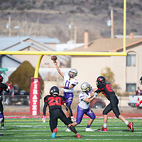 Kirtland quarterback Troy White-David (11) looks to pass  Saturday afternoon in the 2019 4A NMAA State Football Championship quarterfinal game against Grants at Grants High School. Grants beat Kirtland 56-13.