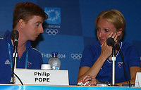 Paula Radcliffe takes a moment to regain her posture as she breaks down in tears during her press conferance explaining her disappointment at withdrawing mid way through the marathon. BOA Press attache Philip Pope (left) Athens Olympics, 23/08/2004. Credit: Colorsport / Matthew Impey DIGITAL FILE ONLY
