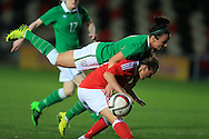 Rachel Rowe of Wales collides with Sophie Perry of Rep of Ireland.   Friendly International Womens football, Wales Women v Republic of Ireland Women at Rodney Parade in Newport, South Wales on Friday 19th August 2016.<br /> pic by Andrew Orchard, Andrew Orchard sports photography.