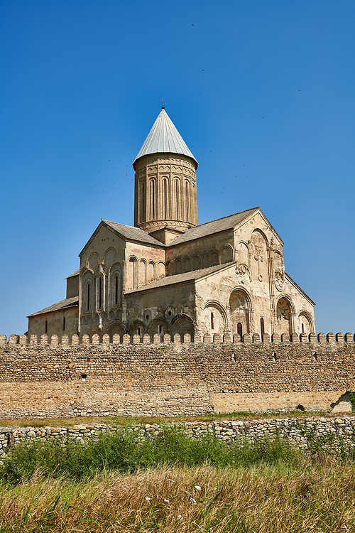 Pictures & images of the medieval Alaverdi St George Cathedral & monastery complex, 11th century, near Telavi, Georgia (country). <br /> <br /> At 50 meters high Alaverdi St George Cathedral was once the highest cathedral in Georgia (now its the nes Tblisi cathedral). The cathedral is part of a Georgian Orthodox monastery founded by the monk Joseph [Abba] Alaverdeli, who came from Antioch and settled in Alaverdi. On the UNESCO World Heritage Site Tentative List. .<br /> <br /> Visit our MEDIEVAL PHOTO COLLECTIONS for more   photos  to download or buy as prints https://funkystock.photoshelter.com/gallery-collection/Medieval-Middle-Ages-Historic-Places-Arcaeological-Sites-Pictures-Images-of/C0000B5ZA54_WD0s .<br /> <br /> Visit our REPUBLIC of GEORGIA HISTORIC PLACES PHOTO COLLECTIONS for more photos to browse, download or buy as wall art prints https://funkystock.photoshelter.com/gallery-collection/Pictures-Images-of-Georgia-Country-Historic-Landmark-Places-Museum-Antiquities/C0000c1oD9eVkh9c
