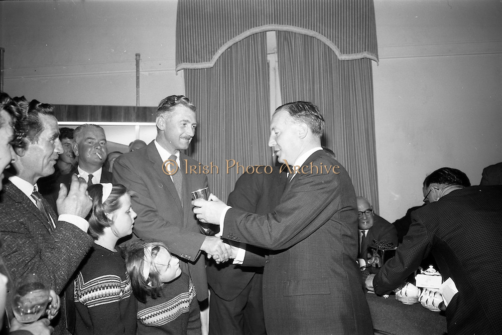 21/08/1966<br /> 08/21/1966<br /> 21 August 1966<br /> European Sea Angling Championship at Howth, Dublin. Picture shows Mr. Charles Haughey (right), Minister for Agriculture and Fisheries, presenting a prize (12th overall) to captain Foote of the Aer Lingus Sea Angling Club at the reception in the Lawrence hotel after the competition.