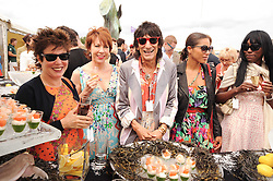 Asprey World Class Cup polo held at Hurtwood Park Polo Club, Ewhurst, Surrey on 17th July 2010.<br /> Picture shows:- RUBY WAX, KATHY LETTE and RONNIE WOOD kissing a fish