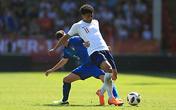 England U17's Xavier Amaechi (right) and Italy U17's Giorgio Brogni battle for the ball during the UEFA European U17 Championship, Group A match at Banks's Stadium, Walsall.