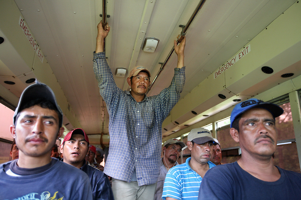Workers ride the camp bus back to their community houses after working the fields.