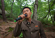 Sunday in North Korea<br /> <br /> What can you do on sunday when you live in a dictatorship? You can hardly fly outside of the for a week end, or take your car to the beach...<br /> So this is the time to enjoy simple activities for the north koreans and the best opportunity for foreigners to meet them as everyone is more relax, including your minders!<br /> <br /> Photo shows:   Karaoke is popular in North Korea and on sunday, with a mobile quipement, people like to sing patriotic and melancholic songs. This is the only time you'll be able to see people really relaxed.<br /> ©Eric Lafforgue/Exclusivepix Media