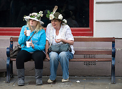 © licensed to London News Pictures. 01/05/2011. Oxford, UK.  A couple of ladies enjoy a drink after May Day celebrations in  Oxford, Oxfordshire today (01/05/02011). Revelers where prevented from jumping from the bridge which is tradition. Please see special instructions for usage rates. Photo credit should read Ben Cawthra/LNP