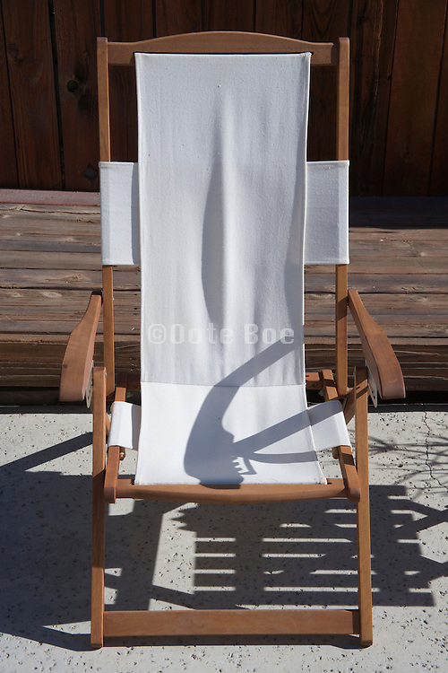 empty garden chair in the sun waiting to be occupied