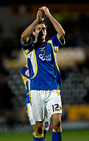 Photo: Jed Wee/Sportsbeat Images.<br /> Hull City v Cardiff City. Coca Cola Championship. 01/12/2007.<br /> <br /> Cardiff's Roger Johnson celebrates with the fans at the end of the match after scoring an injury time equaliser.