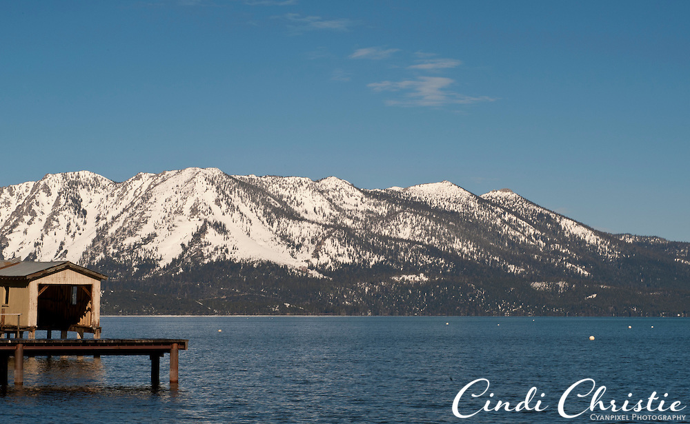 Snow covers the peaks surrounding Lake Tahoe as seen from South Lake Tahoe, Calif., on Tuesday, April 26, 2011. With many hotel rooms vacant during Easter weekend, local business owners hope the warm weather will bring tourists and dollars to the area.   (© 2011 Cindi Christie/Cyanpixel® Photography)