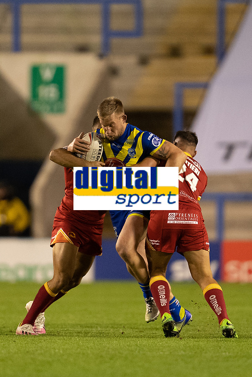 Rugby League - 2020 Super League - Round 13 - Warrington Wolves vs Catalan Dragon<br /> <br /> Warrington Wolves's Mike Cooper is tackled,   at the Halliwell Jones Stadium, Warrington<br /> <br /> <br /> COLORSPORT/TERRY DONNELLY
