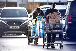 © Licensed to London News Pictures.14/12/2020. London, UK. Shoppers push full trolleys at Costco Chingford, north London. As supermarkets have been warned to stockpile food ahead of a possible no-deal Brexit. Photo credit: Marcin Nowak/LNP