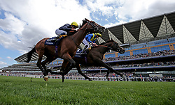 Poet's Word ridden by jockey James Doyle (right) winning the King George VI And Queen Elizabeth Stakes during King George Day at Ascot Racecourse.