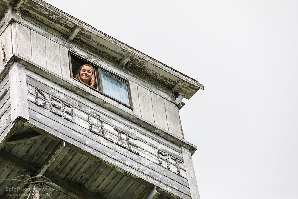 A girl looks out of the fire tower on Deboullie Mountain in Aroostook County, Maine. Deboullie Public Reserve Land.