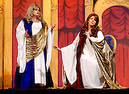 """MERRICK, NY - February 21: Duelling Divas stars, sopranos Birgit Firavante and Wendy Reynolds - wearing Roman cloaks and singing ?Mira, O Norma? and ?Casta Diva? from Bellini's """"Norma"""" - in comic opera concert presented by Merrick Bellmore Community Concert Association on February 21, 2010 at Merrick, NY."""