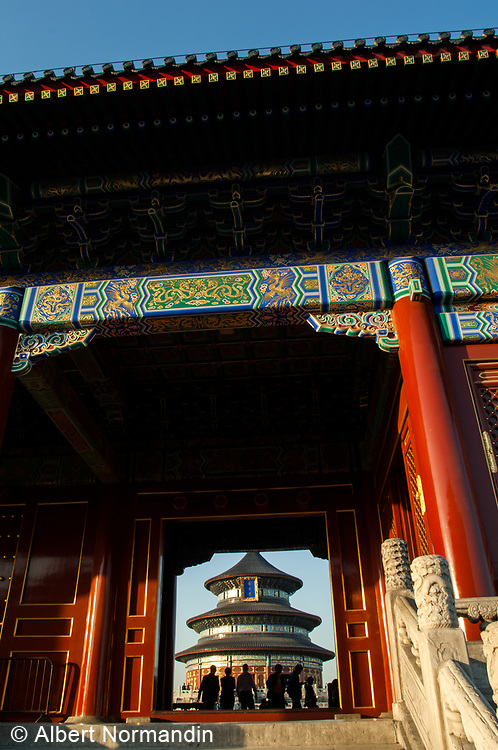 Temple of Heaven archway entrance through main building and silhouette of people, Beijing, China