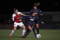 Arsenal Women's Vivianne Miedema (left) and Manchester United Women's Katie Zelem (right) battle for the ball