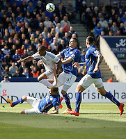 Swansea City's Wayne Routledge (C) is tackled by Leicester City's Marc Albrighton (L), Robert Huth and Marcin Wasilewski (R)<br /> <br /> Photographer Jack Phillips/CameraSport<br /> <br /> Football - Barclays Premiership - Leicester City v Swansea City - Saturday 18th April 2015 - King Power Stadium - Leicester<br /> <br /> © CameraSport - 43 Linden Ave. Countesthorpe. Leicester. England. LE8 5PG - Tel: +44 (0) 116 277 4147 - admin@camerasport.com - www.camerasport.com