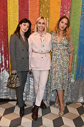 Sydney Lima, Becky Tong and Tess Ward at a cocktail supper hosted by BOTTLETOP co-founders Cameron Saul & Oliver Wayman, along with Arizona Muse, Richard Curtis & Livia Firth to launch the #TOGETHERBAND campaign at The Quadrant Arcade on April 24, 2019 in London, England.<br /> <br /> ***For fees please contact us prior to publication***