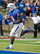 Dec 1, 2012; Tulsa, OK, USA; Tulsa Hurricanes tailback Alex Singleton (8) runs the ball for a touchdown during the first half of a game against the University of Central Florida Knights at Skelly Field at H.A. Chapman Stadium. Mandatory Credit: Beth Hall-US PRESSWIRE