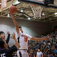 Gallup Bengal Kody Touchine (15) takes a shot under the basket during their 1-4A semi-final tournament game against the Miyamura Patriots Wednesday night at Gallup High School. Gallup took the win 72-39.