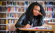 A student inside of the Lyman Beecher Brooks Library.