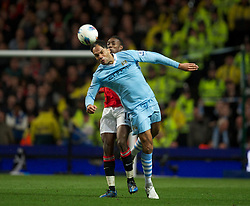 MANCHESTER, ENGLAND - Monday, April 30, 2012: Manchester City's Joleon Lescott in action against Manchester United during the Premiership match at the City of Manchester Stadium. (Pic by David Rawcliffe/Propaganda)