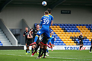 AFC Wimbledon striker Ollie Palmer (9) and AFC Wimbledon striker Joe Pigott (39) going up for a header during the EFL Sky Bet League 1 match between AFC Wimbledon and Lincoln City at Plough Lane, London, United Kingdom on 2 January 2021.