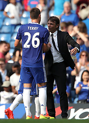 File photo dated 27-08-2016 of Chelsea's John Terry celebrates victory with Chelsea manager Antonio Conte (right).