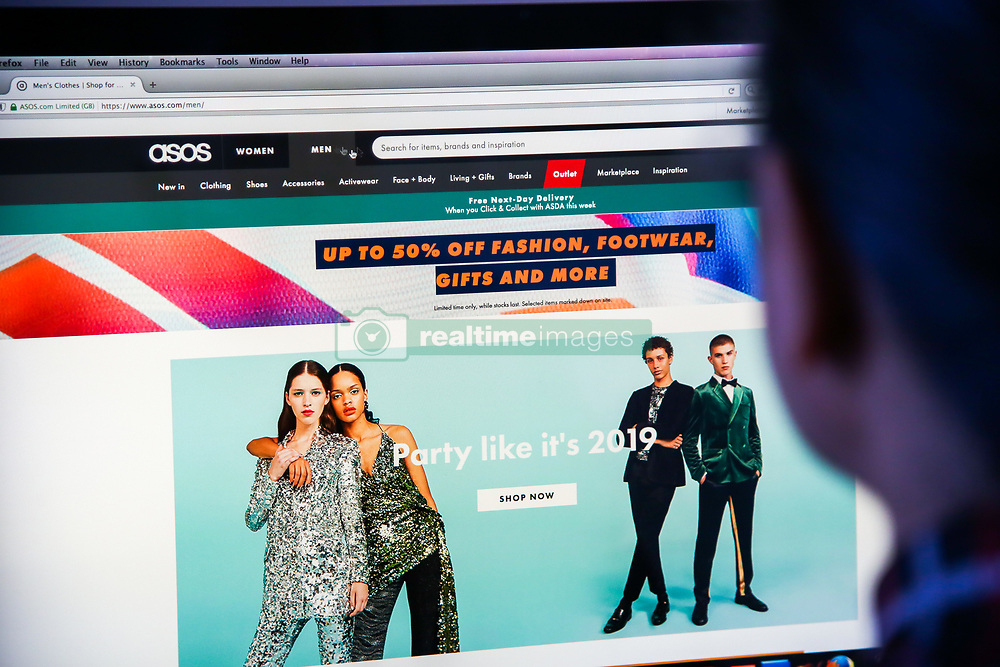December 17, 2018 - London, United Kingdom - A woman is seen shopping on ASOS the online fashion store on a desktop. .Shares in Asos tumbled nearly 40 per cent on Monday morning after the online fashion retailer warned of weak profits this financial year after ''unprecedented'' discounting hit its trading in November. (Credit Image: © Dinendra Haria/SOPA Images via ZUMA Wire)