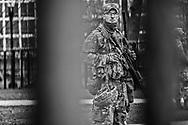 Soldiers behind at metal fence put up around the Capitol Building in Washington DC to secure Biden's inuguration after the insurgency on Jan. 6, 2021.