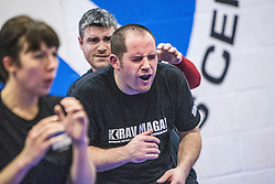 The benefit of wearing a groin guard during one of the exercises. Stef Noij, KMG Instructor from the Institute Krav Maga Netherlands, the IKMS G Level Programme seminar today at the Scottish Martial Arts Centre, Alloa.