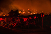 The Shady Fire can been seen on the hillside behind homes in Santa Rosa, CA on September 28, 2020. The wildfire quickly spread over the mountains and reached Santa Rosa where is has begun to affect homes.