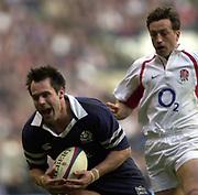 Twickenham, Surrey, 22nd March 2003,  RFU Twickenham Stadium, England, [Mandatory Credit; Peter Spurrier/Intersport Images]<br /> <br /> RBS Six Nations  Rugby England v Scotland<br /> Kenny Logan colleect Dan Luger chipped ball.
