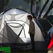 Occupy Los Angeles protesters in their tent city encampment at LA City Hall where they prepared to participate in the global day of protest in demonstration against corporate greed.