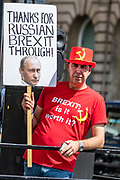 "Anti Brexit campaigner Steve Bray holds up a banner outside Parliament in Central London on Wednesday, July 22, 2020. <br /> The British government - under the Conservative Party leadership of David Cameron, Theresa May and Boris Johnson - failed to conduct serious assessments of Russian attempts to interfere with British elections, including the 2016 Brexit referendum, according to the long-delayed ""Russia Report"" released on Tuesday. (VXP Photo/ Vudi Xhymshiti)"
