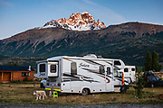 RV camping. The town of Villa Cerro Castillo serves as a handy base for exploring Cerro Castillo National Reserve, in Coyhaique Province, Chile, Patagonia, South America. Steep basalt walls of the mountain Cerro Castillo resemble a castle (or Castillo in Spanish). The peak is 75 km south of the city of Coyhaique along Carretera Austral (CH-7).