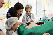 27/11/2016 REPRO FREE:   <br /> Aiste Pivarauskaite (4) from Galway and Toby Leach-Marshall (5) from Oranmore with  Maeve Britton Medtronic enjoying the Medtronic Exhibition inNUI Galway as part of the Galway Science & Technology Festival.enjoy the Medtronic Exhibition inNUI Galway as part of the Galway Science & Technology Festival.  <br /> Photo: Andrew Downes, Xposure.