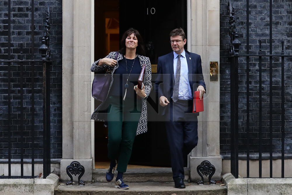 © Licensed to London News Pictures. 16/10/2018. London, UK. Minister of State at the Department for Business, Energy and Industrial Strategy Claire Perry (L) and Secretary of State for Business, Energy and Industrial Strategy Greg Clark (R) leave 10 Downing Street after the Cabinet meeting. Photo credit: Rob Pinney/LNP