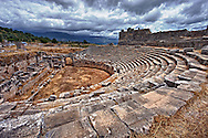 Ampitheatre of Xanthos that has been modified by the Romans with a wall around what would have been the stage to make a pit for Gladitorial & animal events. Xanthos UNESCO World Heritage Archaeological Site, Turkey .<br /> <br /> If you prefer to buy from our ALAMY PHOTO LIBRARY  Collection visit : https://www.alamy.com/portfolio/paul-williams-funkystock/xanthos-lycian-turkey.html<br /> <br /> Visit our ANCIENT WORLD PHOTO COLLECTIONS for more photos to download or buy as wall art prints https://funkystock.photoshelter.com/gallery-collection/Ancient-World-Art-Antiquities-Historic-Sites-Pictures-Images-of/C00006u26yqSkDOM