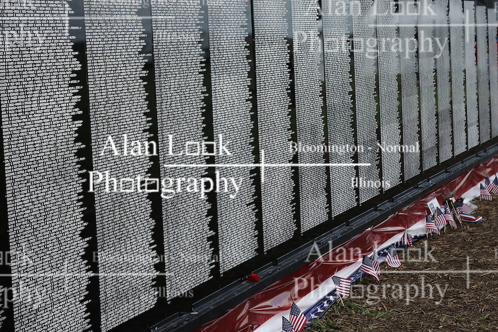 "229 June 2008: The Moving Wall, a traveling replica of the Vietnam Memorial in Washington, D.C., is displayed in Normal Illinois.  The display grounds also had other exhibits including a Vietnam era helicopter and a replica of the statue ""Fallen Soldier""."