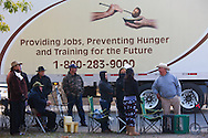 Families wait in line for food distribution in Firebaugh, CA.