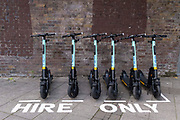 Tier scooters are propped up within a special area for licensed and therefore legal rental eScooters, in Waterloo, SE1, on 8th July 2021, in London, England.
