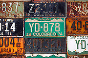 """SHOT 7/08/2007 - A variety of old and outdated Colorado license plates adorn the side of a home in Crested Butte, Colo. Often called """"the last great Colorado ski town"""", Crested Butte is a small resort town located in Gunnison County in the U.S. state of Colorado. A former coal mining hub, Crested Butte is now a destination for skiing, mountain biking, and a variety of other outdoor activities. The Colorado state legislature has designated Crested Butte the wildflower capital of Colorado..(Photo by Marc Piscotty / © 2007)"""
