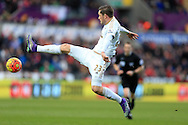 Gylfi Sigurdsson of Swansea city in action. Barclays Premier league match, Swansea city v Norwich city at the Liberty Stadium in Swansea, South Wales  on Saturday 5th March 2016.<br /> pic by  Andrew Orchard, Andrew Orchard sports photography.