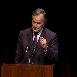 College Station, TX  30NOV04:   Former President George H.W. Bush speaks at the 2004 George Bush Award given to Calitfornia governor Arnold Schwarzenegger for Excellence in Public Service. At the campus of Texas A&M University, site of the George Bush Presidential Library. <br /> ©Bob Daemmrich